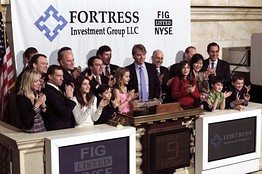 In this NYSE photograph, Fortress Investment Group executives and guests celebrate the hedge fund