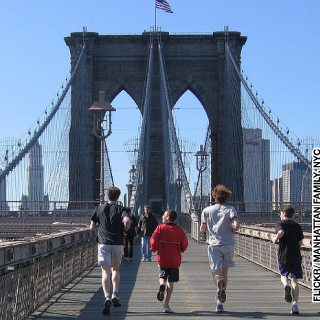 Manhattan-Family-A-family-running-across-the-Brooklyn-Bridge