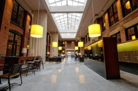 Ceilings as high as 30-feet create a soaring lobby at 220 Water Street.