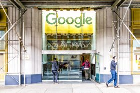 New York City, USA - October 30, 2017: Google company office green sign in downtown lower Chelsea neighborhood district Manhattan NYC, people entering, exiting doors entrance