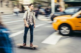 New York, United States - May 5, 2014: Young man commuting on Skateboard down the Greenwich Village in New York.