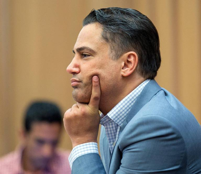 Realtor Kevin Tomlinson, convicted of extorting real estate agent duo known as the Jills, listens to Judge Hirsch speak at his sentencing on Friday August 31, 2018 C.M. GUERRERO (Via Miami Herald)