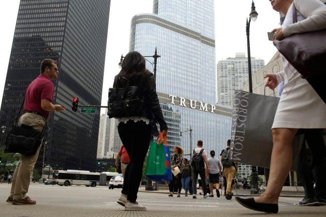 Pedestrians walk near Trump International Hotel & Tower in Chicago. (Joshua Lott/For The Washington Post)