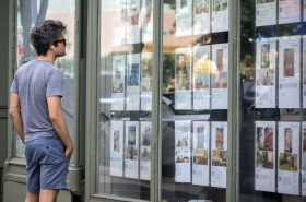 A passer-by browses a brokers listing in the Fort Greene neighborhood of Brooklyn in New York on Saturday, August 8, 2015.