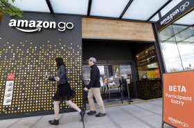 Pedestrians walked past an Amazon Go store in Seattle in April 2017.  PHOTO: ELAINE THOMPSON/ASSOCIATED PRESS