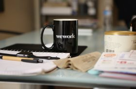 WeWork cup in an office Unsplash.com